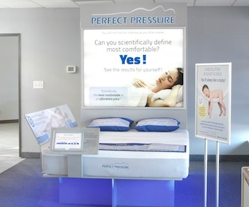 Bed Bath and Beyond Perfect Pressure mattress display with multimedia acrylic signage and backlit snap frame poster holder